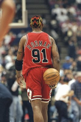 29 Apr 1998: Dennis Rodman #91 of the Chicago Bulls in action during the NBA Playoffs round 3 game against the New Jersey Nets at the Continental Airlines Arena in East Rutherford, New Jersey. The Bulls defeated the Nets 116-101.