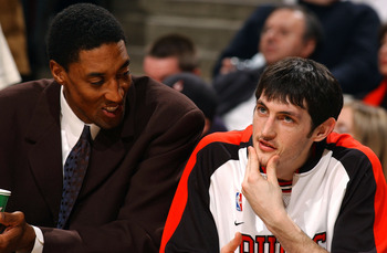 CHICAGO - FEBRUARY 25: Injured forward Scottie Pippen (l) of the Chicago Bulls talks with rookie guard Kirk Hinrich on the bench during a game against the Detroit Pistons on February 25, 2004 at the United Center in Chicago, Illinois. The Pistons defeated