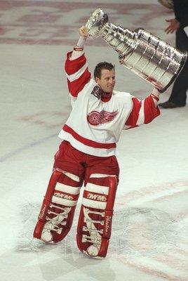 Mike Vernon raises Stanley Cup.