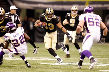 NEW ORLEANS - JANUARY 24:  Pierre Thomas #23 of the New Orleans Saints runs the ball against the Minnesota Vikings during the NFC Championship Game at the Louisiana Superdome on January 24, 2010 in New Orleans, Louisiana. The Saints won 31-28 in overtime.