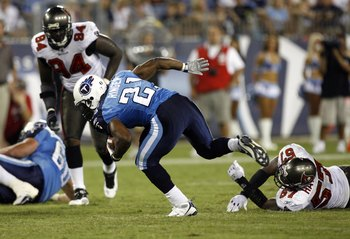 NASHVILLE, TN - AUGUST 15: Javon Ringer #21 of the Tennessee Titans breaks a tackle against Adam Hayward #57 of the Tampa Bay Buccaneers during a preseason NFL game at LP Field on August 15, 2009 in Nashville, Tennessee. The Titans beat the Buccaneers 27-