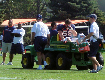 Broncos-training-camp-day-four-nick-greisen-taken-down-by-eddie-royal-3_display_image