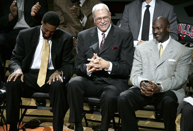 CHICAGO - DECEMBER 9:  (L-R) Scottie Pippen, Phil Jackson and Michael Jordan, formerly of the Chicago Bulls, enjoy a laugh during a ceremony retiring Pippen's #33 at halftime of a game between the Bulls and the Los Angeles Lakers on December 9, 2005 at th