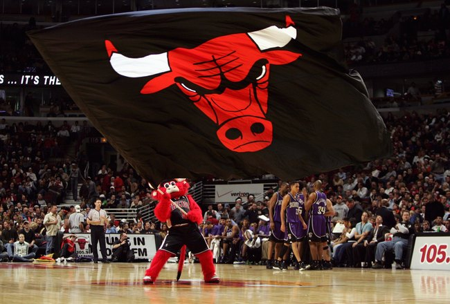 CHICAGO - NOVEMBER 3:  Benny the Bull, the Chicago Bulls mascot, waves the team flag at center court during a game against the Sacramento Kings at the United Center on November 3, 2006 in Chicago, Illinois.  The Kings defeated the Bulls 89-88.  NOTE TO US