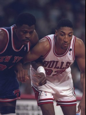 24 Apr 1994: Forward Scottie Pippen of the Chicago Bulls (right) and center Patrick Ewing of the New York Knicks look on during a game at the United Center in Chicago, Illinois. The Knicks won the game, 92-76.