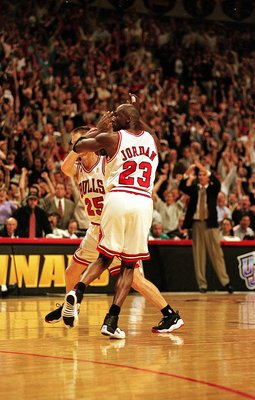 I3 Jun 1997:  Michael Jordan #23 of the Chicago Bulls celebrates with teammates Steve Kerr #25 during game six of the NBA Final against the Utah Jazz at the United Center in Chicago, Illinois. The Bulls defeated the Jazz 90-86..   Mandatory Credit: Jonath