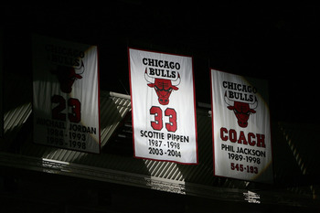 CHICAGO - DECEMBER 9:  A banner with the number of former Chicago Bull Scottie Pippen is unfurled during a ceremony retiring his #33 at halftime of a game between the Bulls and the Los Angeles Lakers on December 9, 2005 at the United Center in Chicago, Il