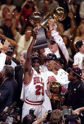 13 Jun 1997:  Michael Jordan #23 and Scottie Pippen of the Chicago Bulls celebrate with the trophy after winning game 6 of the 1997 NBA Finals at the United Center in Chicago, Illinois. The Bulls defeated the Jazz 90-86 to win the series and claim the cha