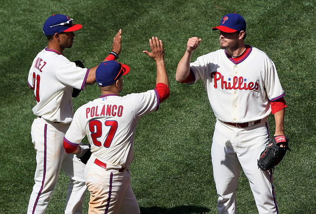 PHILADELPHIA - MAY 06:  Chad Durbin #37 of the Philadelphia Phillies congratulates his teammates Wilson Valdez #21 and Placido Polanco #27 after they completed an eigth inning ending double play against the St. Louis Cardinals at Citizens Bank Park on May