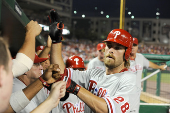 WASHINGTON - JULY 30:  Jayson Werth #28 of the Philadelphia Phillies is congratulated by teammates after hitting a home run in the seventh inning against the Washington Nationals at Nationals Park on July 30, 2010 in Washington, DC.  (Photo by Greg Fiume/
