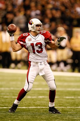 NEW ORLEANS - JANUARY 16:  Quarterback Kurt Warner #13 of the Arizona Cardinals throws a pass against the New Orleans Saints during the NFC Divisional Playoff Game at Louisana Superdome on January 16, 2010 in New Orleans, Louisiana. The Saints won 45-14. 