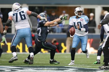 SEATTLE - JANUARY 03:  Vince Young #10 of the Tennessee Titans looks for a receiver while being pressured by Patrick Kerney #97 of the Seattle Seahawks as David Stewart #76 blocks on January 3, 2010 at Qwest Field in Seattle, Washington. (Photo by Otto Gr