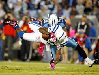 NASHVILLE, TN - OCTOBER 11:  Reggie Wayne #87 of the Indianapolis Colts is tackled by Jason McCourty #30 of the Tennessee Titans during the NFL game at LP Field on October 11, 2009 in Nashville, Tennessee. The Colts defeated the Titans 31-9.  (Photo by An