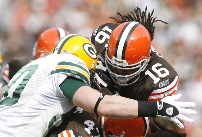 CLEVELAND, OH - OCTOBER 25:  Joshua Cribbs #16 of the Cleveland Browns is hit by A.J. Hawk #50 and Clay Matthews #52 of the Green Bay Packers at Cleveland Browns at Cleveland Browns Stadium on October 25, 2009 in Cleveland, Ohio.  (Photo by Matt Sullivan/