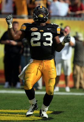 TAMPA, FL - JANUARY 01:  Shonn Green #23 of the Iowa Hawkeyes celebrates a touchdown run against the South Carolina Gamecocks during the Outback Bowl on January 1, 2009 at Raymond James Stadium in Tampa, Florida.  (Photo by Scott Halleran/Getty Images)