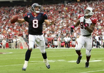 GLENDALE, AZ - OCTOBER 11:  Quarterback Matt Schaub #8 of the Houston Texans scrambles to pass under pressure from Calais Campbell #93 of the Arizona Cardinals during the NFL game at the Universtity of Phoenix Stadium on October 11, 2009 in Glendale, Ariz