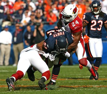 CHICAGO - NOVEMBER 08: Matt Forte #22 of the Chicago Bears is tackled by Chike Okeafor #56 and Adrian Wilson #24 of the Arizona Cardinals at Soldier Field on November 8, 2009 in Chicago, Illinois. The Cardinals defeated the Bears 41-21. (Photo by Jonathan