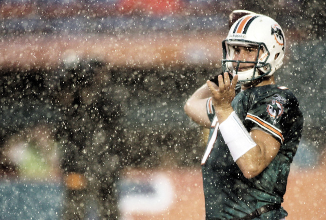 MIAMI - AUGUST 14:  Quarterback Chad Henne #7   of the Miami Dolphins passes in heavy rain against  the Tampa Bay Buccaneers during the preseason game at Sun Life Stadium on August 14, 2010 in Miami, Florida.  (Photo by Marc Serota/Getty Images)