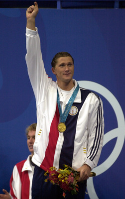 21 Sep 2000:  Lenny Krayzelburg of the USA celebrates with his gold medal after victory in the Mens 200m Backstroke Final during the Sydney 2000 Olympic Games at the Aquatic Centre, Olympic Park, Sydney, Australia. DIGITAL IMAGE. Mandatory Credit: Ross Ki