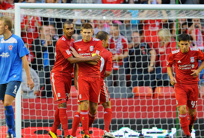 LIVERPOOL, ENGLAND - AUGUST 05:  David Ngog and Steven Gerrard of Liverpool celebrate Gerrard's goal during the Europa League, Third Qualifying Round, Second Leg match between Liverpool and FK Rabotnicki at Anfield on August 5, 2010 in Liverpool, England.