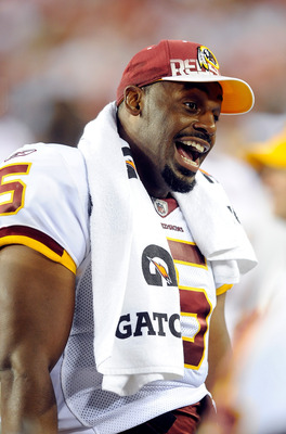 LANDOVER, MD - AUGUST 13:  Donovan McNabb #5 of the Washington Redskins talks to teammates during the preseason game against the Buffalo Bills at FedEx Field on August 13, 2010 in Landover, Maryland.  (Photo by Greg Fiume/Getty Images)
