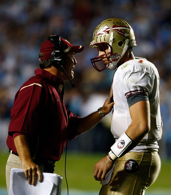 CHAPEL HILL, NC - OCTOBER 22:  Florida State Seminoles Offensive Coordinator Jimbo Fisher speaks with his quarterback Christian Ponder #7 during their game against the North Carolina Tar Heels at Kenan Stadium on October 22, 2009 in Chapel Hill, North Car