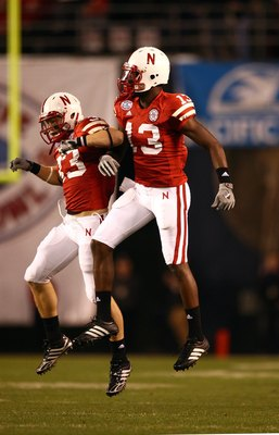 SAN DIEGO - DECEMBER 30:  P.J. Smith #13 and Matt O'Hanlon #33 of the University of Nebraska Cornhuskers celebrate after a defensive play during the Pacific Life Holiday Bowl against University of Arizona Wildcats on December 30, 2009 at Qualcomm Stadium