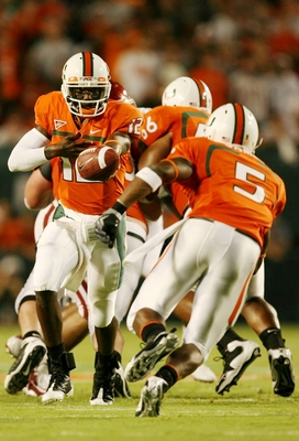 MIAMI GARDENS, FL - OCTOBER 3:  Quarterback Jacory Harris #12 of the Miami Hurricanes looks to pass the ball against the Oklahoma Sooners in the second quarter of the game on October 3, 2009 at Landshark Stadium in Miami Gardens, Florida. (Photo by Doug B