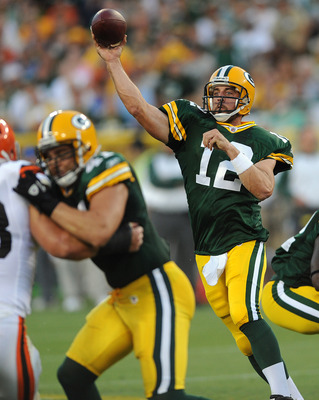 GREEN BAY - AUGUST 14: Aaron Rodgers #12 of the Green Bay Packers passes during the NFL preseason game against the Cleveland Browns at Lambeau Field August 14, 2010 in Green Bay, Wisconsin.  (Photo by Tom Dahlin/Getty Images)