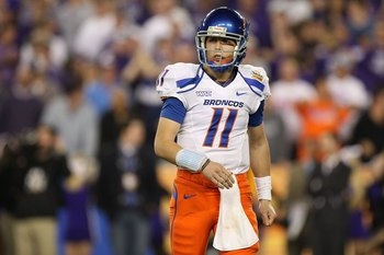 GLENDALE, AZ - JANUARY 04:  Quarterback Kellen Moore #11 of the Boise State Broncos looks over to his sideline in the second half against the TCU Horned Frogs during the Tostitos Fiesta Bowl at the Universtity of Phoenix Stadium on January 4, 2010 in Glen