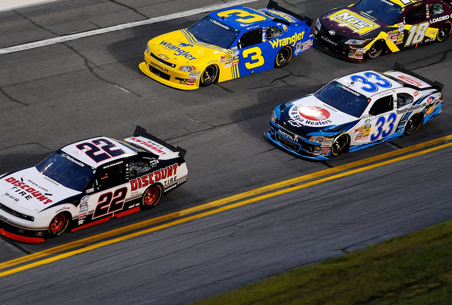 DAYTONA BEACH, FL - JULY 02:  Brad Keselowski, driver of the #22 Discount Tire Dodge, leads Dale Earnhardt Jr., driver of the #3 Wrangler Chevrolet, Kyle Busch, driver of the #18 NOS Toyota, and Kevin Harvick, driver of the #33 Rheem Chevrolet, during the