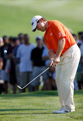 AKRON, OH - AUGUST 06:  Lee Westwood of England chips to the green on the tenth hole during the second round of the World Golf Championships - Bridgestone Invitational on the South Course at Firestone Country Club on August 6, 2010 in Akron, Ohio.  (Photo