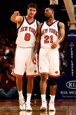 NEW YORK - OCTOBER 29:  Danilo Gallinari #8 of the New York Knicks and teammate Wilson Chandler #21 talk during a break in the action against the Miami Heat at Madison Square Garden October 29, 2008 in New York City. NOTE TO USER: User expressly acknowled