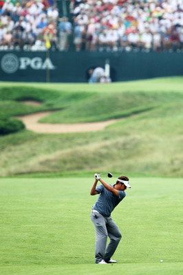 KOHLER, WI - AUGUST 13:  Jeff Overton hits his approach shot on the 16th hole during the continuation of the first round of the 92nd PGA Championship on the Straits Course at Whistling Straits on August 13, 2010 in Kohler, Wisconsin.  (Photo by Andy Lyons