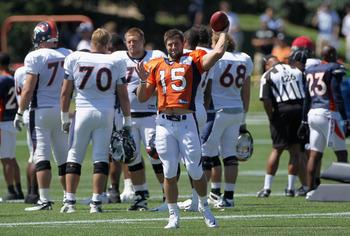 ENGLEWOOD, CO - AUGUST 05:  Rookie quarterback Tim Tebow #15 of the Denver Bronocs tosses the ball as he takes part in practice during training camp at Dove Valley on August 5, 2010 in Englewood, Colorado.  (Photo by Doug Pensinger/Getty Images)