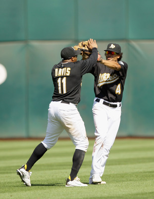 Coco Crisp (right) and Rajai Davis can run Oakland past contenders.