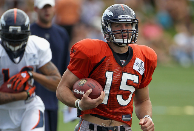 ENGLEWOOD, CO - AUGUST 05:  Quarterback Tim Tebow #15 of the Denver Bronocs takes part in practice during training camp at Dove Valley on August 5, 2010 in Englewood, Colorado.  (Photo by Doug Pensinger/Getty Images)