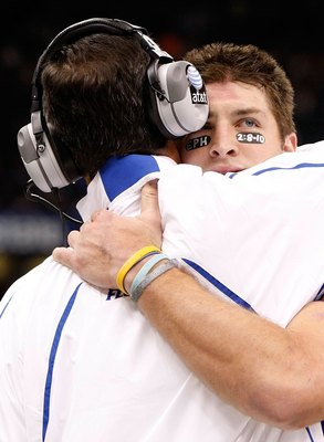 NEW ORLEANS - JANUARY 01:  Tim Tebow #15 of the Florida Gators hugs his head coach Urban Meyer after scoring a touchdown against the Cincinnati Bearcats during the Allstate Sugar Bowl at the Louisana Superdome on January 1, 2010 in New Orleans, Louisiana.