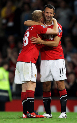 MANCHESTER, ENGLAND - AUGUST 16:  Ryan Giggs of Manchester United celebrates with team mate Paul Scholes after scoring his team's third goal during the Barclays Premier League match between Manchester United and Newcastle United at Old Trafford on August