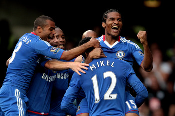 LONDON, ENGLAND - AUGUST 14:  Florent Malouda #15 (R) of Chelsea is congratulated by teammates after scoring the opening goal during the Barclays Premier League match between Chelsea and West Bromwich Albion at Stamford Bridge on August 14, 2010 in London