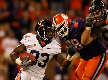 CLEMSON, SC - NOVEMBER 21:  Perry Jones #33 of the Virginia Cavaliers runs with the ball against the Clemson Tigers during their game at Memorial Stadium on November 21, 2009 in Clemson, South Carolina.  (Photo by Streeter Lecka/Getty Images)