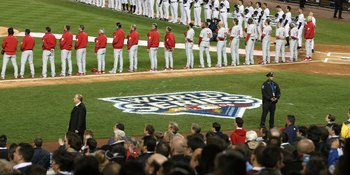 NEW YORK - OCTOBER 28:  A general view of the New York Yankees and the Philadelphia Phillies standing for the National Anthem prior to Game One of the 2009 MLB World Series at Yankee Stadium on October 28, 2009 in the Bronx borough of New York City.  (Pho