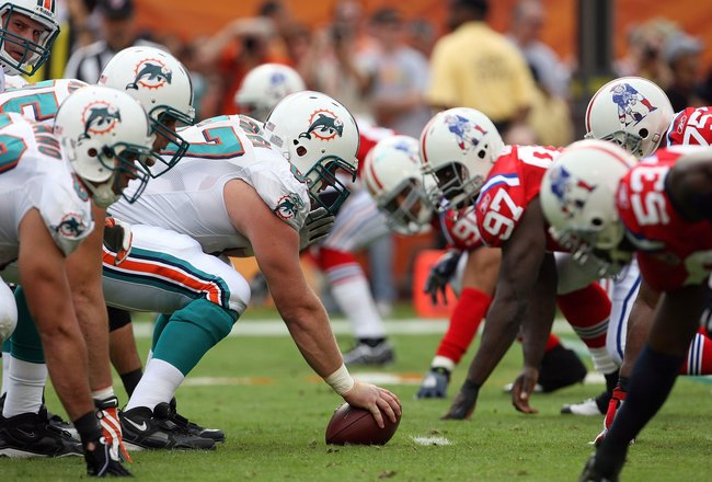 MIAMI - DECEMBER 06:  Quarterback Chad Henne #7 of the Miami Dolphins prepares to take the snap from center Joe Berger #67 while taking on the New England Patriots at Land Shark Stadium on December 6, 2009 in Miami, Florida. The Dolphins defeated the Patr
