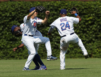 CHICAGO - JULY 16: (L-R) Alfonso Soriano #12, Tyler Colvin #21 and Marlon Byrd #24 of the Chicago Cubs celebrate a win over the Philadelphia Phillies at Wrigley Field on July 16, 2010 in Chicago, Illinois. The Cubs defeated the Phillies 4-3. (Photo by Jon
