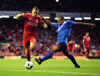 LIVERPOOL, ENGLAND - AUGUST 05:  Joe Cole of Liverpool in action during the Europa League, Third Qualifying Round, Second Leg match between Liverpool and FK Rabotnicki at Anfield on August 5, 2010 in Liverpool, England.  (Photo by Clive Mason/Getty Images