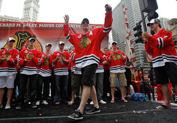 CHICAGO - JUNE 11: Patrick Sharp #10 waves the crowd during the Chicago Blackhawks Stanley Cup victory parade and rally on June 11, 2010 in Chicago, Illinois. (Photo by Jonathan Daniel/Getty Images)