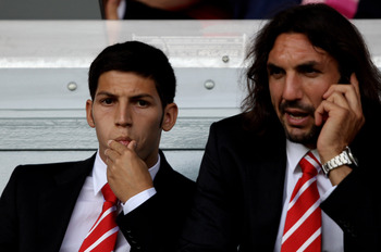 LIVERPOOL, ENGLAND - AUGUST 15:  Dani Pacheco (L) of Liverpool looks on during the Barclays Premier League match between Liverpool and Arsenal at Anfield on August 15, 2010 in Liverpool, England. (Photo by Clive Brunskill/Getty Images)