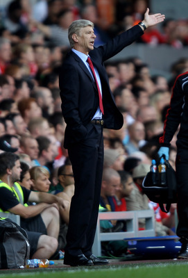LIVERPOOL, ENGLAND - AUGUST 15:  Arsenal Manager Arsene Wenger gestures during the Barclays Premier League match between Liverpool and Arsenal at Anfield on August 15, 2010 in Liverpool, England. (Photo by Clive Brunskill/Getty Images)