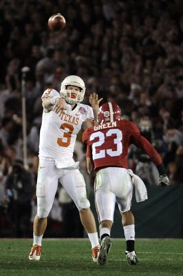 PASADENA, CA - JANUARY 07:  Quarterback Garrett Gilbert #3 of the Texas Longhorns drops back to pass against the Alabama Crimson Tide during the Citi BCS National Championship game at the Rose Bowl on January 7, 2010 in Pasadena, California.  (Photo by Ha