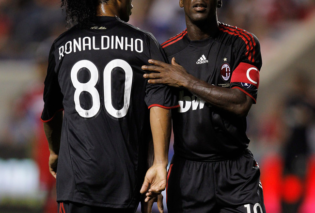 CHICAGO - MAY 30:  Clarence Seedorf #10 and Ronaldinho #80 of AC Milan greet each other as Ronaldinho is taken out of the match in the second half while taking on the Chicago Fire during an international friendly at Toyota Park on May 30, 2010 in Chicago,